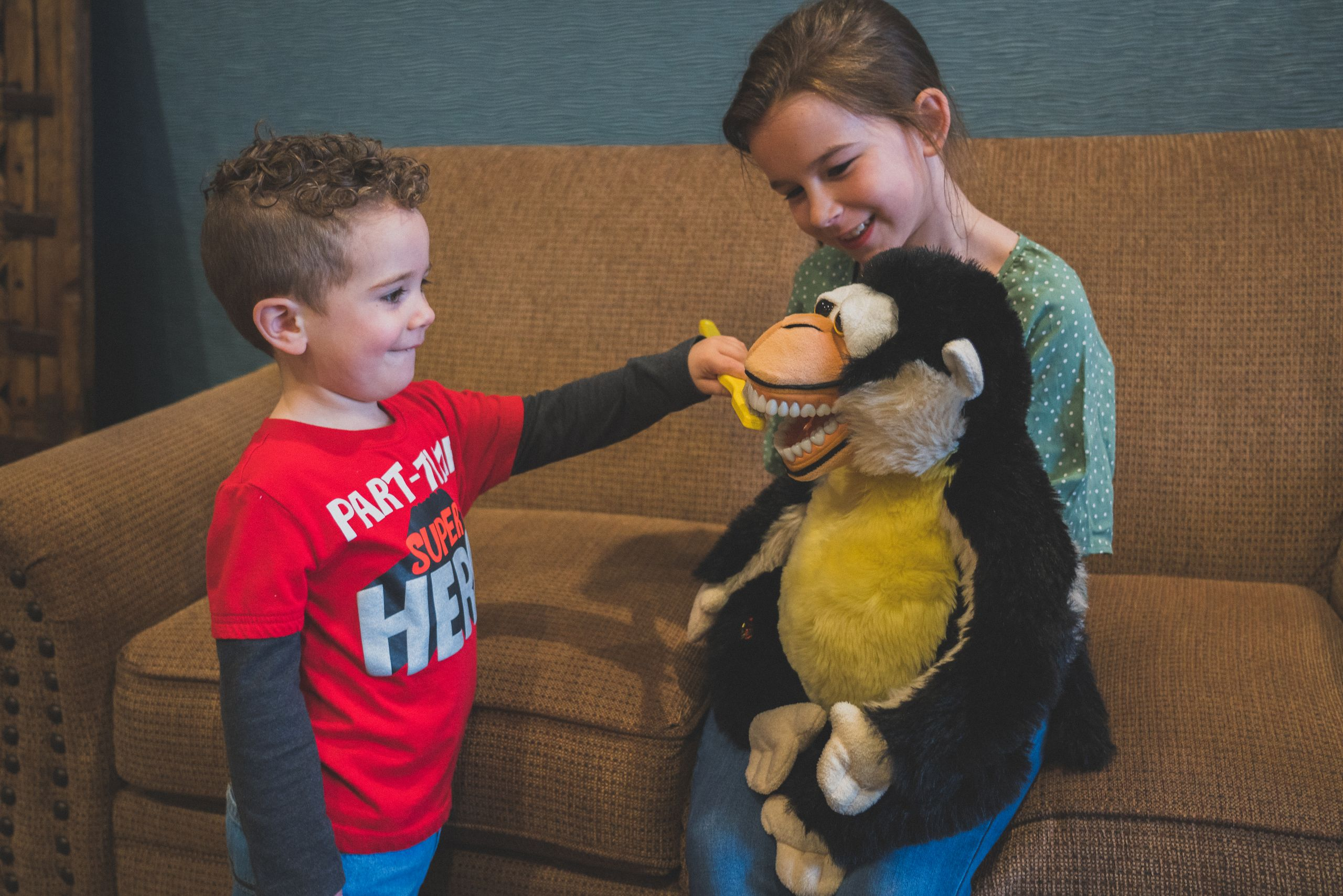 Image of a young boy brushing the teeth of a stuffed animal for the family dentistry page.