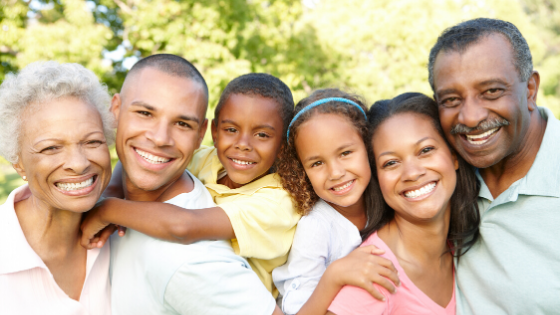 Image of a family with three generations for the family dentistry page.